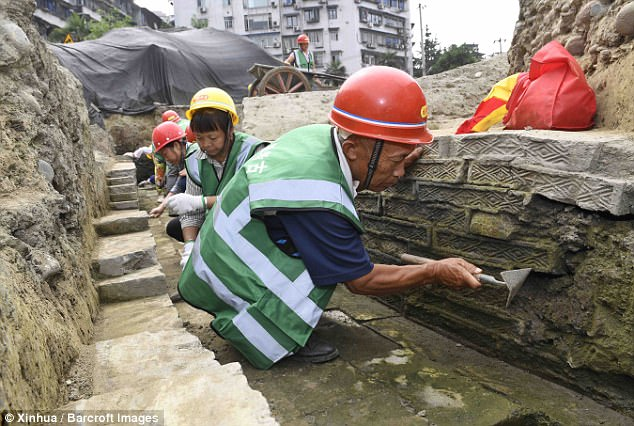 The Fugan Temple was a famous place of worship that existed from the Eastern Jin Dynasty (317-420) to the Southern Song Dynasty (1127-1279). Pictured are archaeologists working on the site